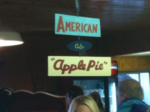 "Photo of sign stating ""American as Apple Pie"""